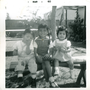 1960-03-joe-mich-n-girl-on-backyard-bench