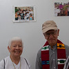 Sister Maritze and Father Javier Giraldo in front of a photo of themselves, taken several years earlier.