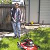 Scott mowing lawn