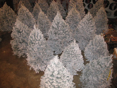 Flocked trees ready for sale