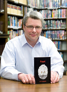 Belvidere author L.M. Roberts with his new book Feast.
