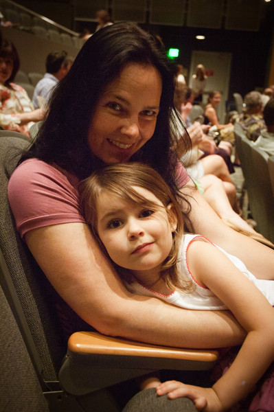 Maggi and River about to watch Gwen on stage for a ballet performance.