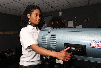 One of Noelle Richards' jobs as a member of the theater technology crew at St. Pius X High School, Atlanta, was to operate the spotlight.   (Page 4, May 26, 2011 issue)