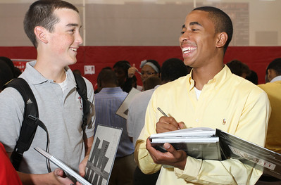 Pierce Vincent, right, laughs with sophomore Thomas Smilie about a moment from the 2010-2011 school year as he signs a fellow student's yearbook. Vincent will attend the University of Georgia, Athens, where plans to major in engineering.   (Page 3, May 26, 2011 issue)