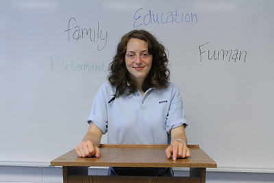 Standing behind a podium and surrounded by words that have special significance to her, Lannon Gustafson plans to attend Furman University, Greenville, S.C. Gustafson is considering a profession in education.