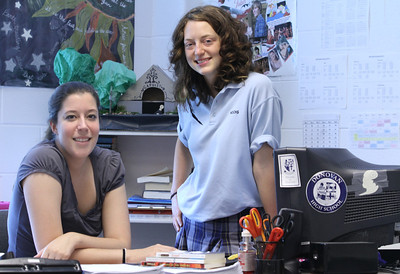 Lannon Gustafson, right, stands beside one of her favorite teachers at Monsignor Donovan High School, Athens, English instructor Shannon Juhan.   (Page 2, May 26, 2011 issue)