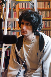 001 Adam Jaffe: Taken Janurary 1st 2011 at KUSP Studios while GeekSpeak is on air. Adam is probably listening to his brother Ben speak.