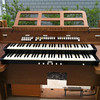 """Whitney writes, """"WE'RE GETTING A NEW ORGAN AT ST. DAVID'S! Here's a picture of our old one out on the curb. It's going to live at the farm with Grandma and Grandpa where it has plenty of room to run and play."""""""