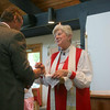 Bishop Cate offers the bread -