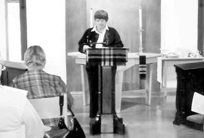 Phyllis addresses those who slid into church for the Annual Meeting.
