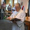 The Gospel is read by Deacon Anderson