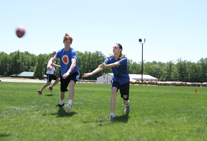 Zayne Rice, left, plays defense against his sister Madison as they practice flag football for her team's upcoming participation in the annual Special Olympics Georgia state summer games May 20-22 at Emory University. Zayne has helped out as a Special Olympics buddy in Forsyth County since he was 8-years-old. Photo By Michael Alexander