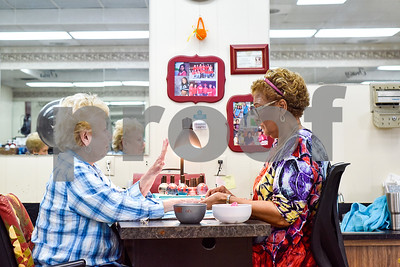 Jeanne Blair looks at her nails as Joyce Francis paints the nails on Blair's other hand at Fenton Salon in Tyler, Texas, on Tuesday, April 18, 2017. Francis has had a 65 yearlong career in cosmetology and has only worked at Fenton Salon. (Chelsea Purgahn/Tyler Morning Telegraph)