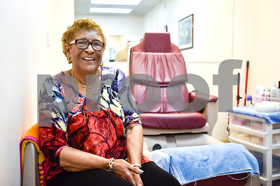 Joyce Francis poses for a portrait by a pedicure chair at Fenton Salon in Tyler, Texas, on Tuesday, April 18, 2017. Francis has had a 65 yearlong career in cosmetology and has only worked at Fenton Salon. (Chelsea Purgahn/Tyler Morning Telegraph)