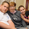 Evelyn Treadwell, center, sits with her grandchildren William Vargo III, 12, and Victoria Vargo, 9, who where with her when she had a heart attack. William called 911 and Victoria called their mom. This quick thinking saved her life. SENTINEL & ENTERPRISE/JOHN LOVE