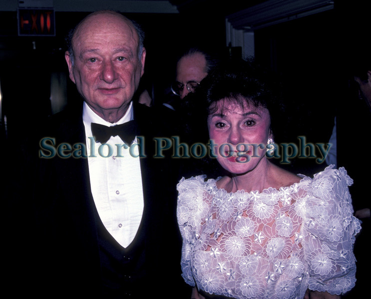 Former New York City Mayor Edward Koch at a party on 2 May 1992 standing with Mrs. Jan Chipman.<br /> File No. 020592 12<br /> ©RLLord<br /> fishinfo@guernsey.net