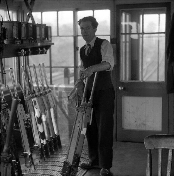 During the 1950s there were three regular signalmen employed at Southcote Junction, all of whom offered access to the warmth of the signal box and cheery company.  Perhaps the one we got to know best was Ken Sweetzer, pictured here.  Ken was a great painter and did his best to teach me to paint in oils, without great success it has to be said.  There are still some of his paintings adorning our walls.