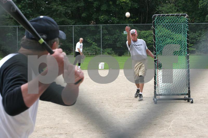 Seniors playing softball.