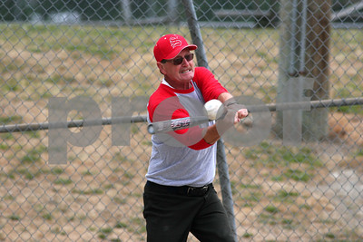 Senior playing softball.