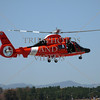 US Coast Guard helicopter performs a rescue demonstration during the Airshow and Festival at March Air Reserve Base in Moreno Valley, California.