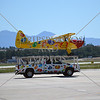 Jelly Belly airplane lands atop a platform mounted on a pickup truck during the 2016 Air Show event at March Air Reserve Base near Moreno Valley, California.