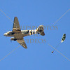 A vintage aircraft drops a load during an air show event at March Air Reserve Base near Moreno Valley, California.