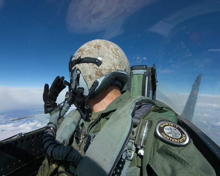 Instructor WSO from MAWTS-1 looks for agressor aircraft during an Air Combat Tactics Instructor certification.