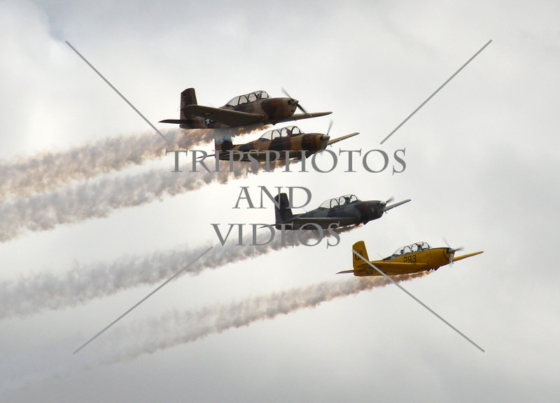Vintage airplanes flyover with smoke  during the 2018 Airshow at March Air Reserve Base in Moreno Valley, California.