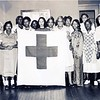 Women Holding a Red Cross Flag (08476)