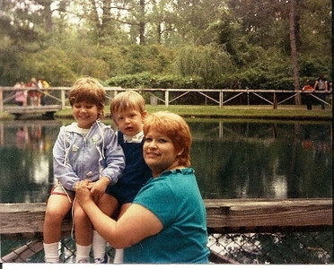 Leticia Chavez Fischer balances her children, Margie and Rob, on a fence at the Blue Hole at Castalia, Ohio, around 1985. She sometimes took them to National Education Association conventions across the country for mini-vacations.