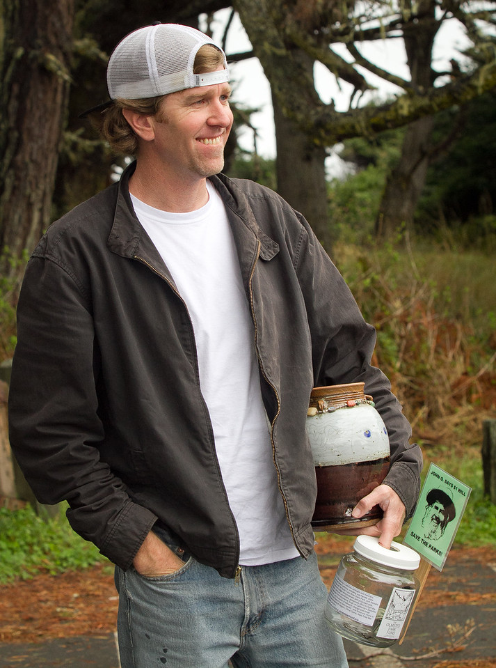 Alden Olmsted walks with his fathers ashes and a donation jar in Jug Handle State Park in Caspar, Calif. on March 16th, 2012. Olmsted is collecting private money to save California State Parks on the closure list.