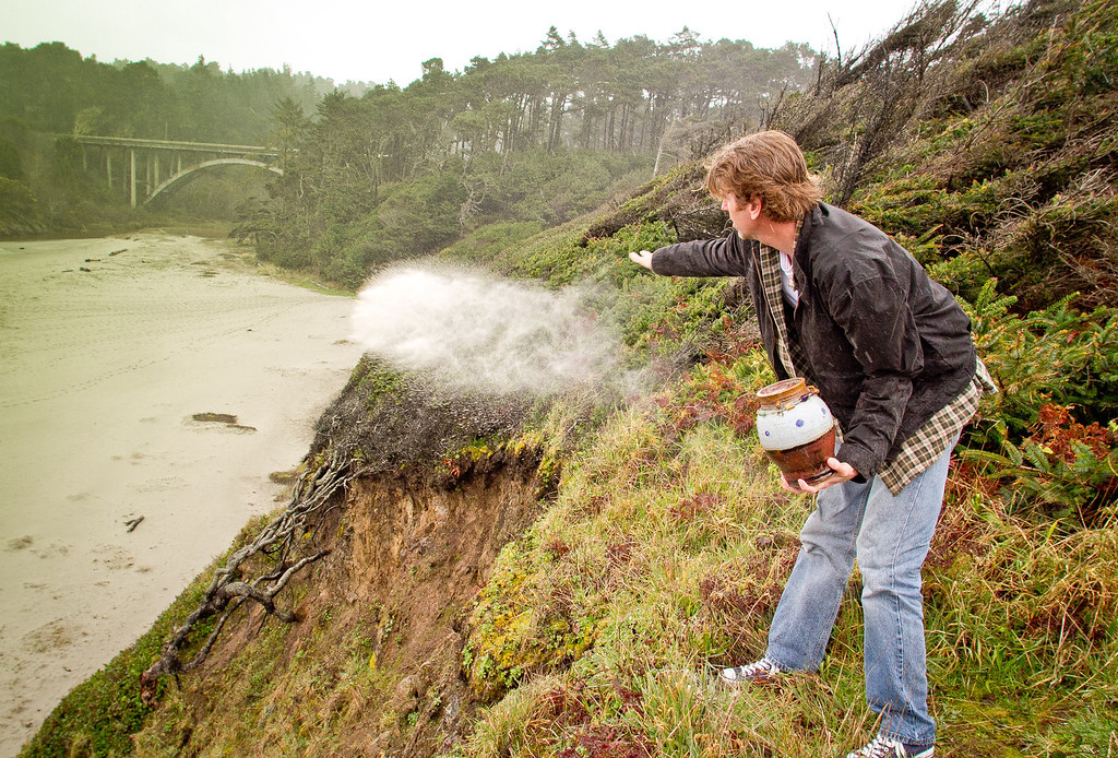 Alden Olmsted scatters the ashes of his father in Jug Handle State Park in Caspar, Calif. on March 16th, 2012. Olmsted is collecting private money to save California State Parks on the closure list.