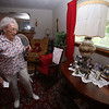 Allie Casazza of Tewksbury recently celebrated her 100th birthday. In her living room are old family photos. (SUN/Julia Malakie)