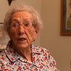 Allie Casazza of Tewksbury, speaking to reporter in her dining room, recently celebrated her 100th birthday with family and friends. (SUN/Julia Malakie)