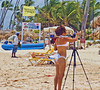 The best beach photographers come out with a good camera, tripod, bikini and yes, a pina colada in their non-shooting hand.