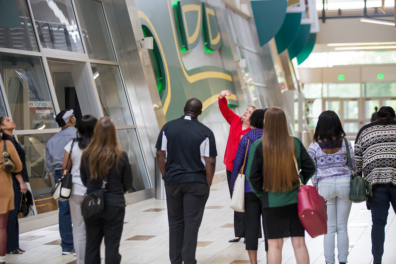 """Tlisa Northcutt leads a group of alumni gathering to discuss the creation of a new 'Multi-Cultural Alumni' chapter through UAA and tour the Alaska Airlines Athletics Center.  <div class=""""ss-paypal-button"""">20160518-Multi-cultural-alumni-meet-007-TEK.JPG</div><div class=""""ss-paypal-button-end""""></div>"""