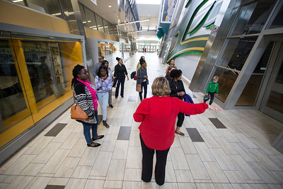 Tlisa Northcutt leads a group of alumni gathering to discuss the creation of a new 'Multi-Cultural Alumni' chapter through UAA and tour the Alaska Airlines Athletics Center.  20160518-Multi-cultural-alumni-meet-008-TEK.JPG