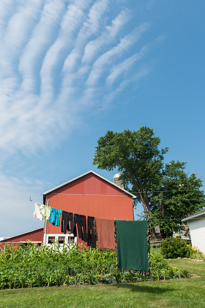 Laundry Against Red Barn And Painted Sky