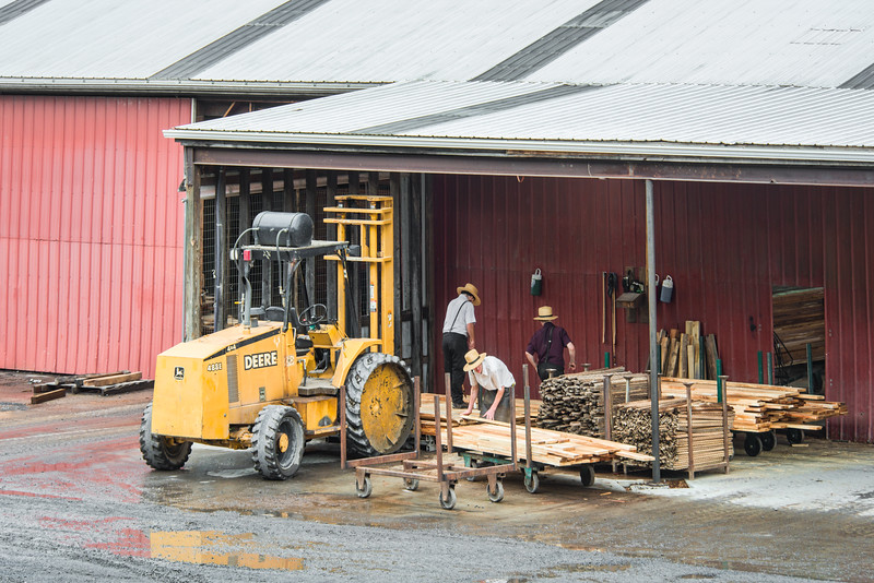 Amish Men Working At Lumber Company