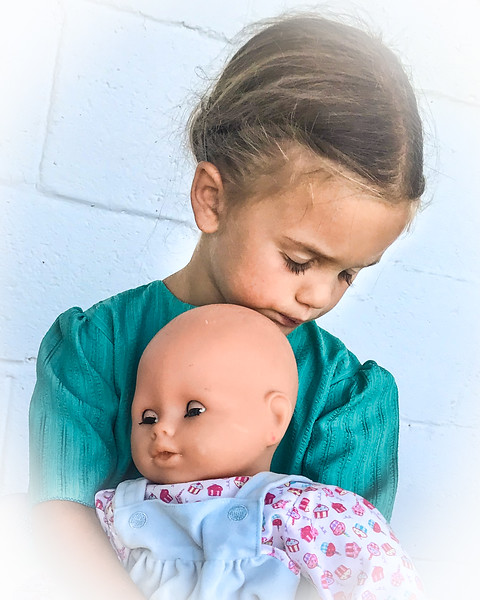 Young Amish Girl With Her Doll