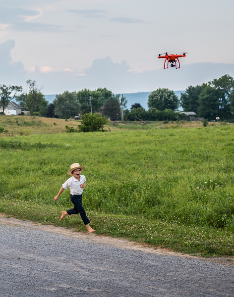 Young Amish Boy Delights In Watching Drone