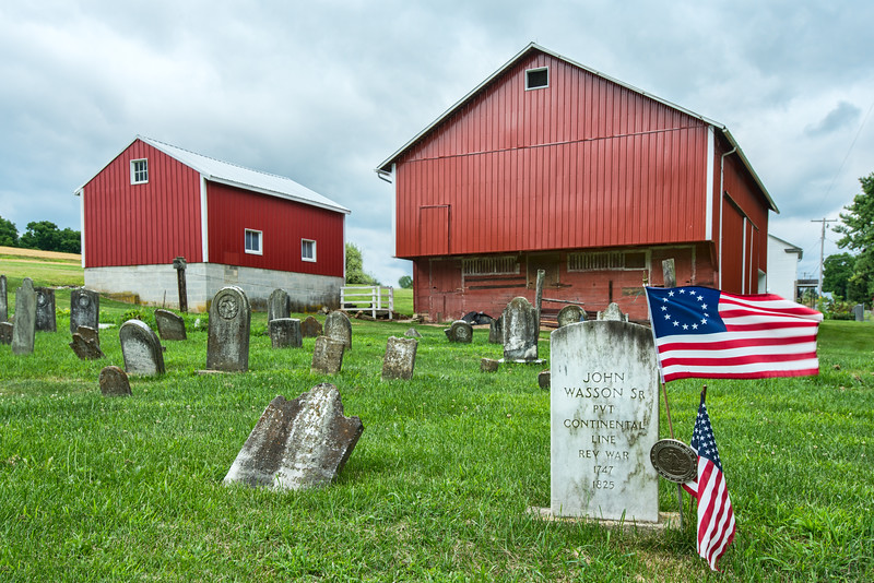 Revolutionary War Flag and Commemorative Medal By Grave Of Fallen Soldier