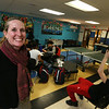 Boys & Girls Club of Greater Lowell director of development Angel Brunelle, recent recipient of an award from the MA Alliance of Boys & Girls Clubs, in the Teen Center, one of the spaces improved with funding she obtained.  (SUN/Julia Malakie)