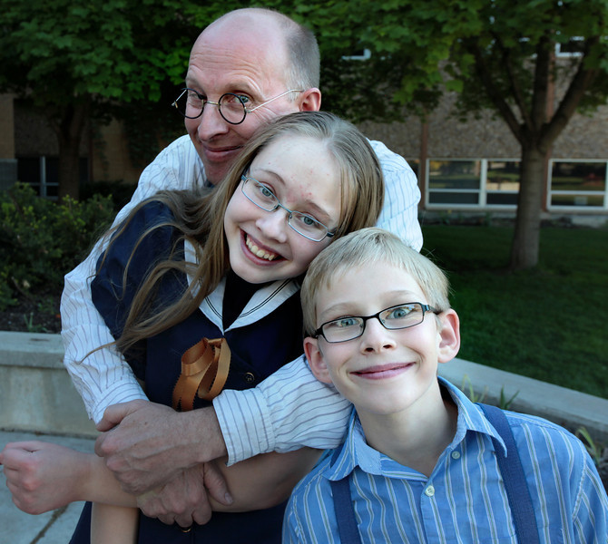 Chris Rasmussen with his two children, Erika and Andrew.
