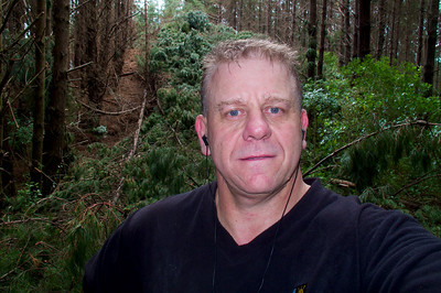 Tony with fallen pines behind on the the Extended Pylon Walk Mar 2012.