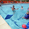 """Swim teacher Dan Graham, top center,  reacts to a goal scored during a game for his class on Wednesday.<br /> The new aquatics facility at the YMCA of Boulder Valley Arapahoe Center has its grand opening on June 12, in Lafayette.<br /> For a video and more photos, go to  <a href=""""http://www.dailycamera.com"""">http://www.dailycamera.com</a>.<br /> Cliff Grassmick / June 9, 2010"""