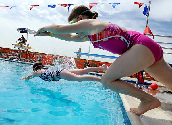 "Cassie Roberts, left, and Anneka Pawlak, practice dives during swim class on Wednesday.<br /> The new aquatics facility at the YMCA of Boulder Valley Arapahoe Center has its grand opening on June 12, in Lafayette.<br /> For a video and more photos, go to  <a href=""http://www.dailycamera.com"">http://www.dailycamera.com</a>.<br /> Cliff Grassmick / June 9, 2010"