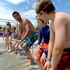 "Dan Graham shows his students diving technique during a swim class on Wednesday.<br /> The new aquatics facility at the YMCA of Boulder Valley Arapahoe Center has its grand opening on June 12, in Lafayette.<br /> For a video and more photos, go to  <a href=""http://www.dailycamera.com"">http://www.dailycamera.com</a>.<br /> Cliff Grassmick / June 9, 2010"