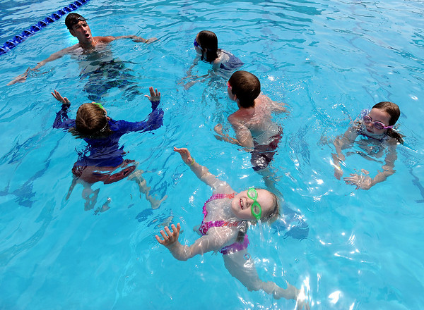 "Anneka Pawlak, bottom, soaks up some sun while staying afloat in Dan Graham's, top left, swimming class.<br /> The new aquatics facility at the YMCA of Boulder Valley Arapahoe Center has its grand opening on June 12, in Lafayette.<br /> For a video and more photos, go to  <a href=""http://www.dailycamera.com"">http://www.dailycamera.com</a>.<br /> Cliff Grassmick / June 9, 2010"