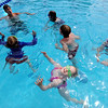 """Anneka Pawlak, bottom, soaks up some sun while staying afloat in Dan Graham's, top left, swimming class.<br /> The new aquatics facility at the YMCA of Boulder Valley Arapahoe Center has its grand opening on June 12, in Lafayette.<br /> For a video and more photos, go to  <a href=""""http://www.dailycamera.com"""">http://www.dailycamera.com</a>.<br /> Cliff Grassmick / June 9, 2010"""